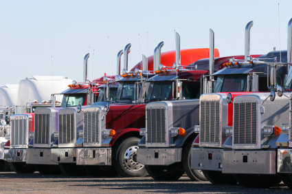 A Row of Red Semi Trucks