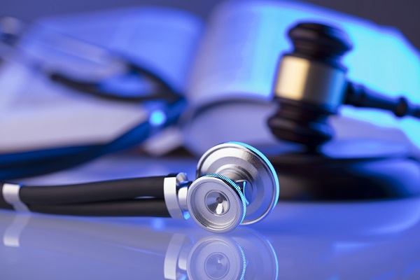 Stethoscope and Justice Scales. Medical Malpractice
